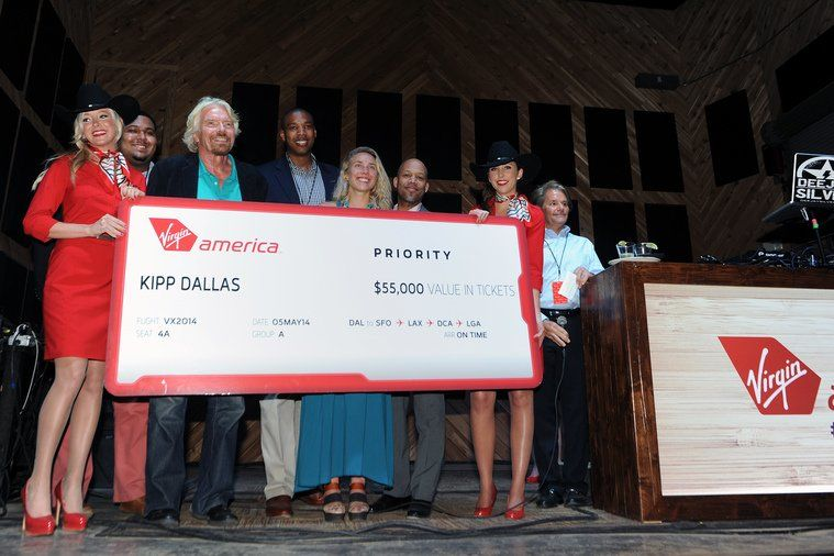 Richard Branson gives a cheque from Virgin America to KIPP in Dallas