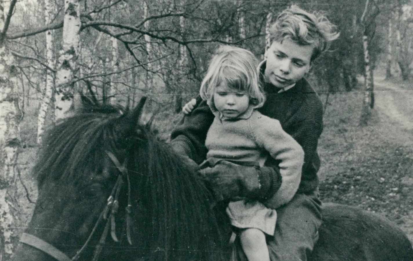 Young Richard Branson riding a horse with his sister