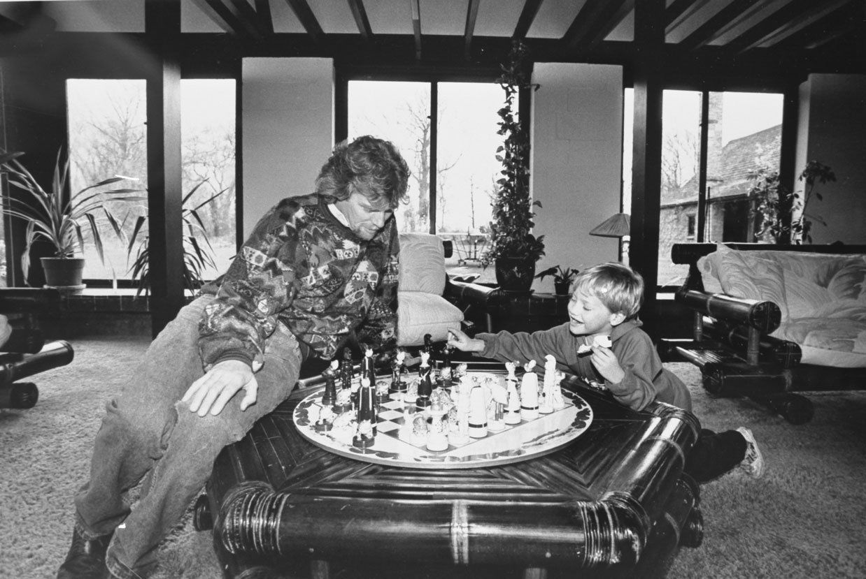 Richard Branson and Sam Branson playing chess