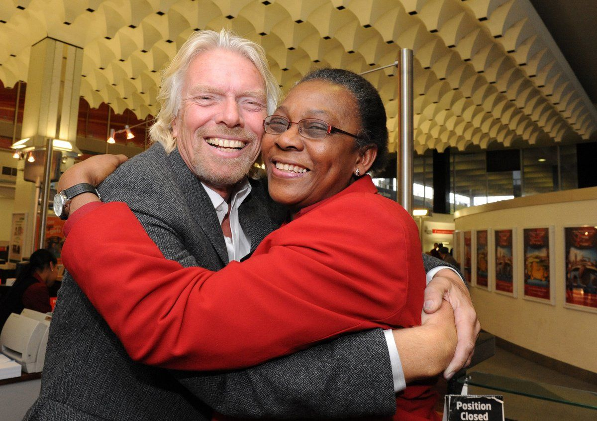 Richard Branson hugging Virgin Trains employee