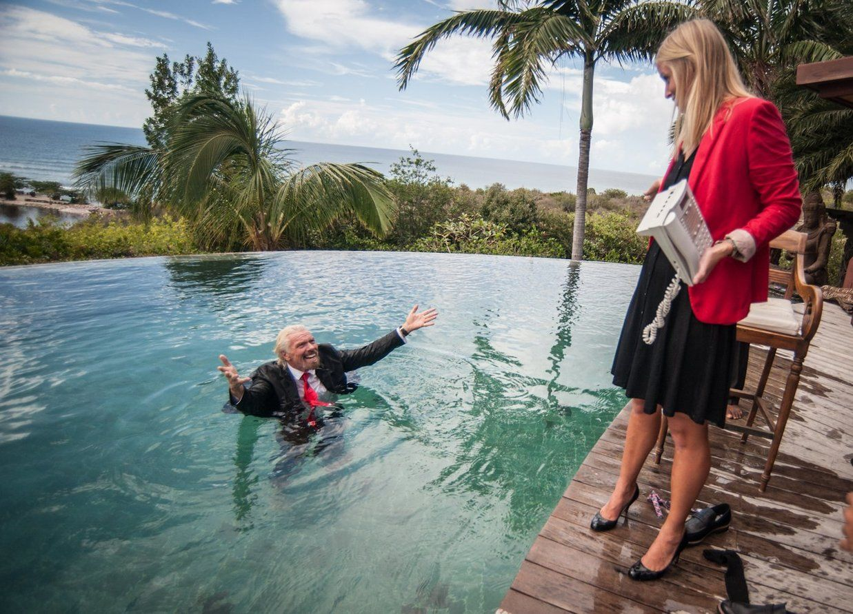 Richard Branson in a suit in a pool for Corporate Day