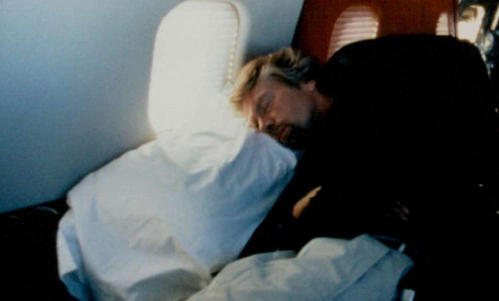 Richard Branson sleeping on a plane