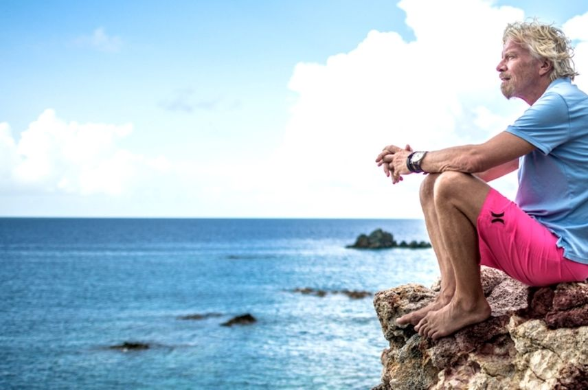 Richard Branson looks out over the ocean on Moskito Island