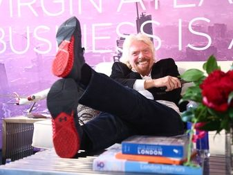 Richard Branson feet up Virgin Atlantic Business is an Adventure