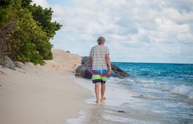 Richard Branson walking on the beach