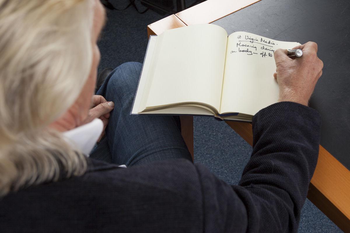 Richard Branson taking notes