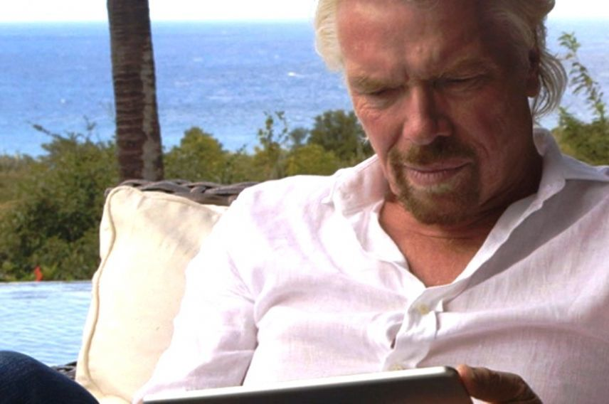 Richard Branson using an ipad