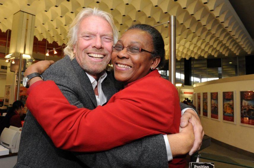 Richard Branson hugging Virgin Trains employee