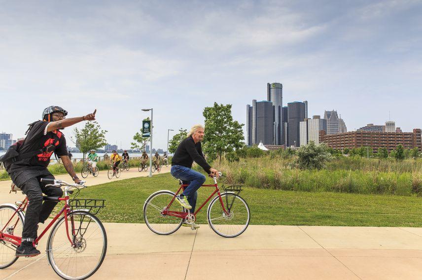 Richard Branson cycling in Detroit