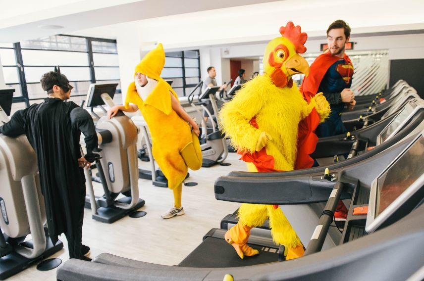 Man in chicken suit on treadmill at Virgin Active