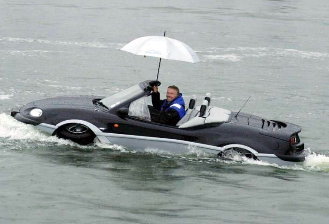 Richard Branson in Virgin Atlantic aqua car
