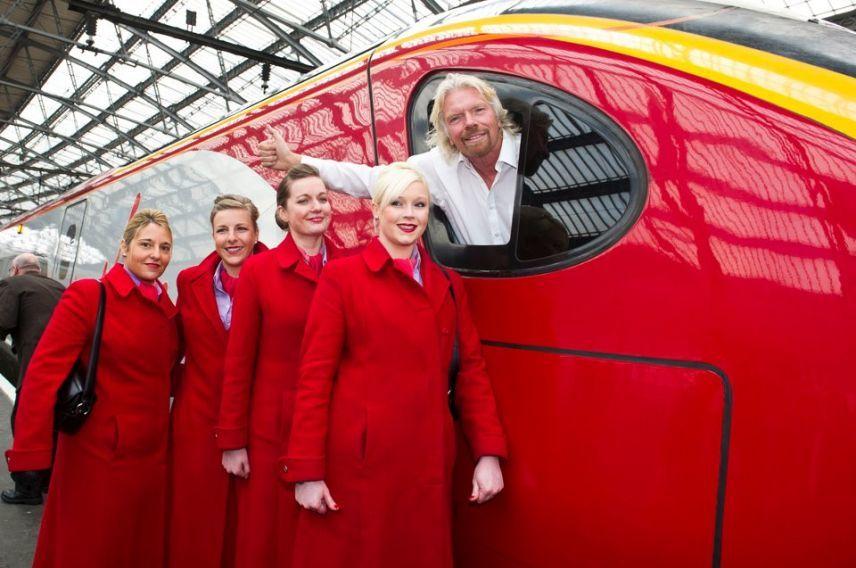 Richard Branson driving Virgin Trains