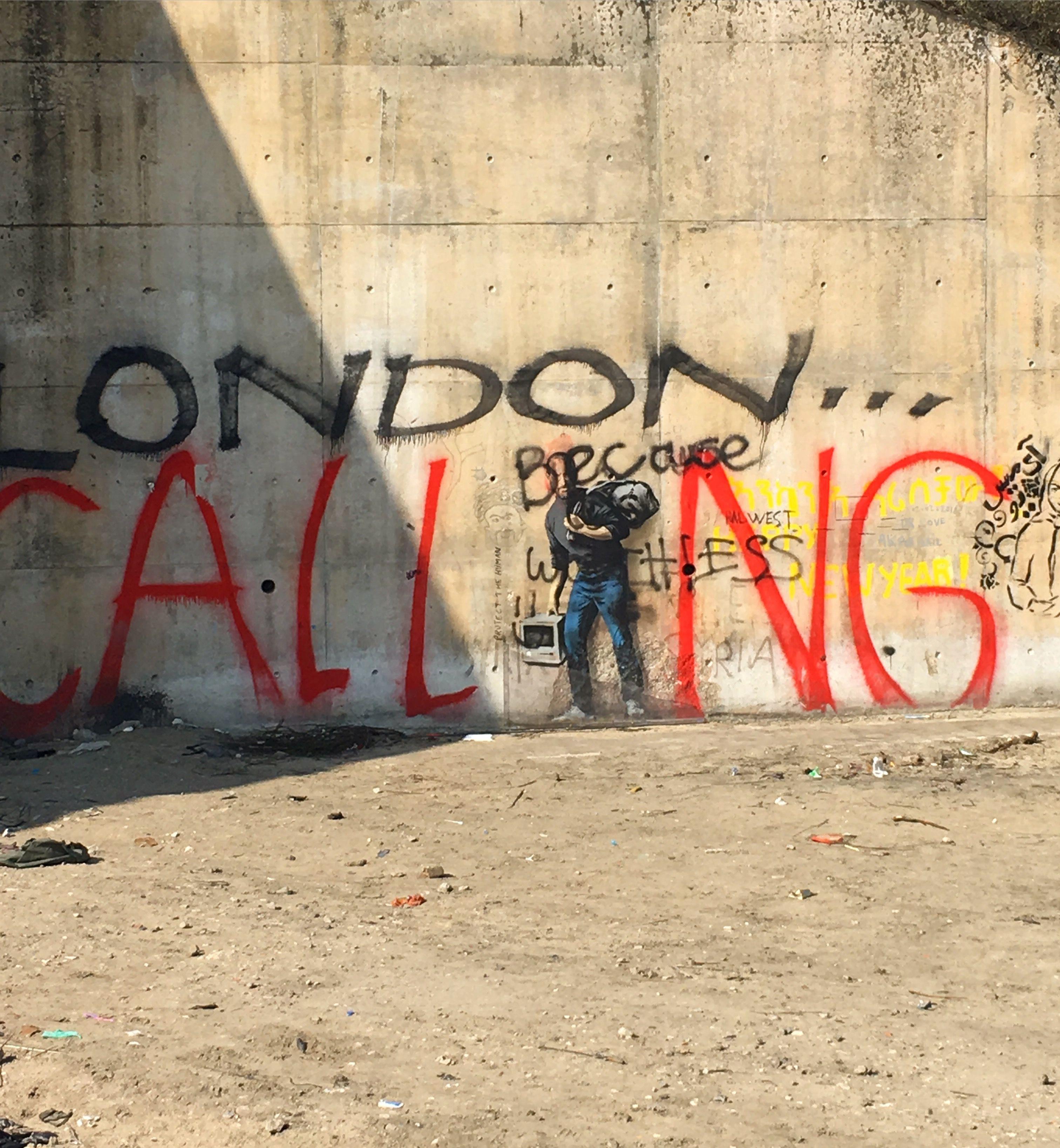 Calais jungle Banksy graffiti