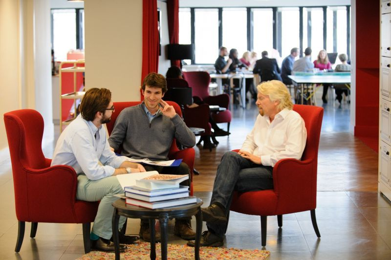 Richard Branson and staff in a meeting at the Battleship