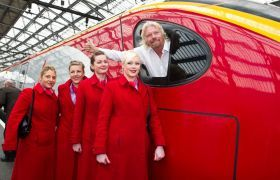 Richard Branson driving Virgin Trains