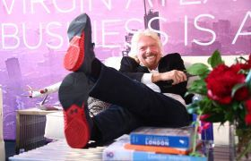 Richard Branson feet up Virgin Atlantic Business is an Adventure
