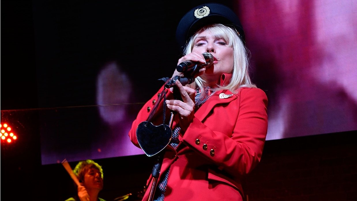 Blondie performing in uniform