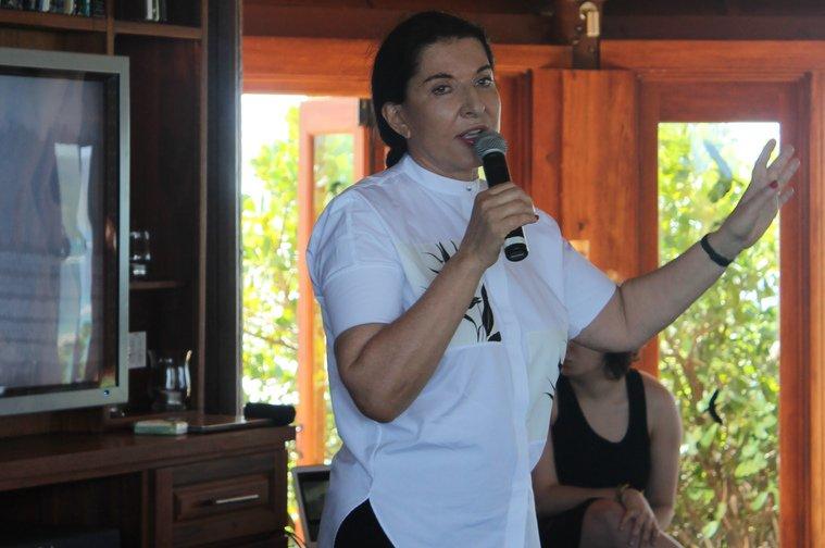 Marina speaking to the gathering