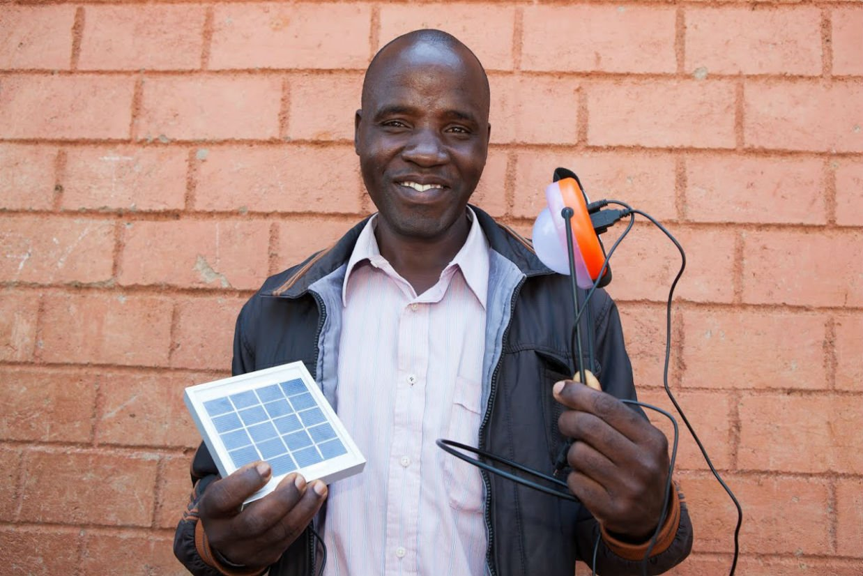 Man Holds Pico-Solar Light
