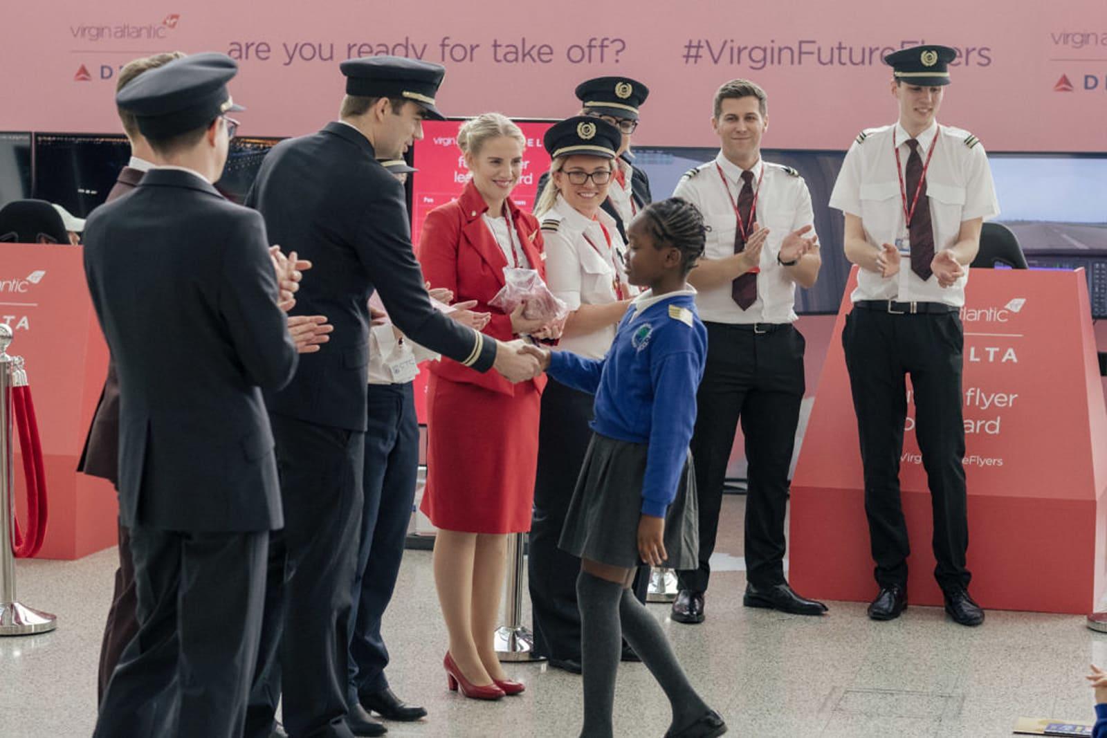 A young schoolgirl receives special edition Virgin Atlantic 'wings'