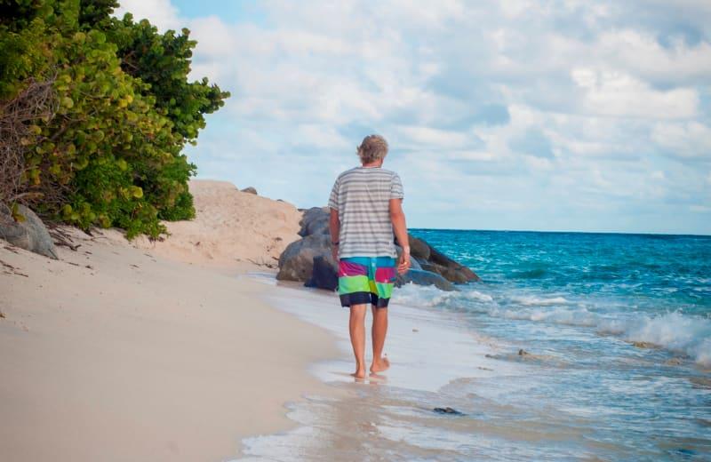 Richard Branson walking on the beach
