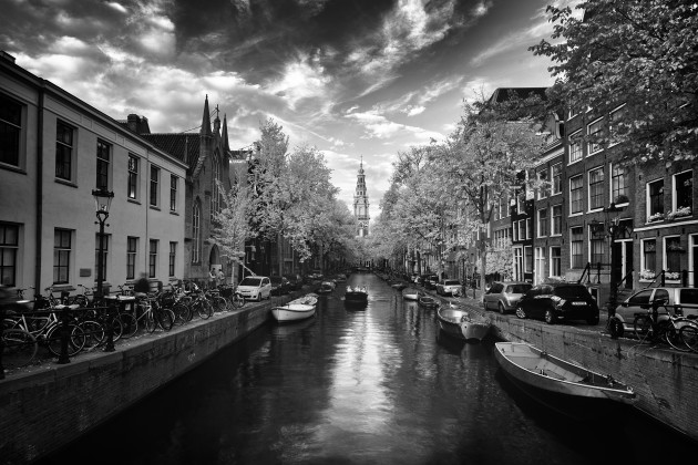 Amsterdam Canals, The Netherlands. Spending a day wandering around Amsterdam with my infrared camera was a thoroughly enjoyable experience. The clouds and light were looking just right when I shot this classic canal scene. Canon 5D Mark II converted to 720nm infrared, Canon TS-E 17mm f/4L, 0.4 seconds @ f9, ISO 100, tripod. Monochrome conversion in Silver Efex Pro, curves adjustments in Photoshop CC.
