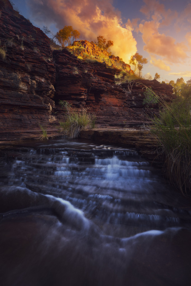 On my way out of one of Karijini's stunning gorges, the setting sun was catching a rock face above me. I only got a couple of frames before the clouds blocked the sun again. I waited for another 20 minutes or so, but it never came back. Sony A7R, Zeiss 24-70mm lens @ 24mm, 5 seconds at f16, ISO 100.