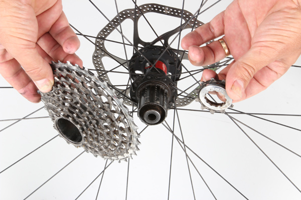 In addition to the 36 cog, your donor cassette needs individually mounted cogs lower down on the cassette so that one can be removed. In this example, our bike had a one-piece SRAM XX unit, so the cassette had to be swapped for a cheaper model—we went with a PG 1050. If you're faced with a similar scenario, we'd recommend sticking to like-branded parts; run a SRAM cassette if you've got a SRAM chain and derailleur, or stick with a Shimano cassette if it's the other way around. Mounting a massive 42 cog with a rear derailleur that wasn't designed to take anything bigger than a 36 places extra demands on the shifting; the last thing you need is a mix and match drivechain adding even greater potential for shifting problems.