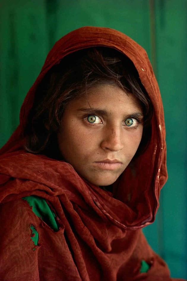 Afghan Girl, Peshawar, Pakistan, 1984. Arguably McCurry's most iconic image, and certainly his most famous shot. The image resonates deeply with a wide and diverse audience. Copyright Steve McCurry.