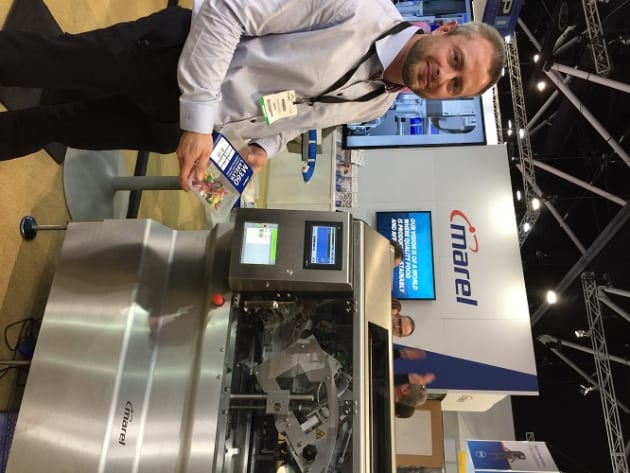 The company was showcasing its new M360, a linerless wraparound labeller that has just been launched in Australia. The label comes with glue strips and a silicone band so it requires no backing paper, reducing waste and allowing more labels per reel. The packaged meat tray product runs through a weighing unit, according to David Lynch, who was on the stand. This calculates the product weight, and the M360 prints on to the label, cuts the label and applies it to a tray. The label can wrap all the way around the tray or in a C-wrap, just around the top and sides. The machine does 90 trays per minute and can be adjusted for different-sized products in just a few seconds. The label allows more space for product information so brands can make a bigger splash on the retail shelf.