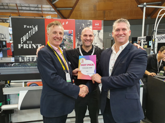 Hot Pick: Craig Nethercott (right) and Andy Cocker (centre) receive the award for the Colorado 1650 from Wayne Robinson at PrintEx