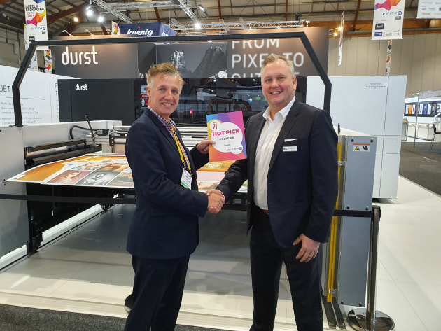 Flagship: Matt Ashman, Durst (right) accepts the Hot Pick for the P5 250 HS.