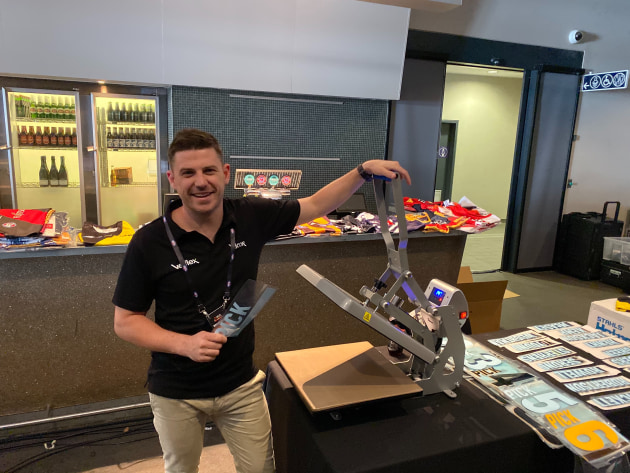 Less than a minute: Velflex CEO Ben Carroll printing shirts at the AFL Draft
