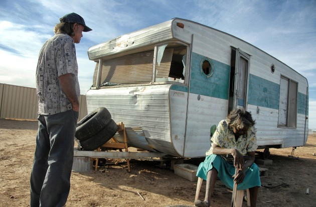 Urandangie, Queensland. A picture of despair - Norman and Mavis Wilde outside their wrecked van home in the far western Queensland community of Urandangi. The community of nearly 100 has no power, no water, no sanitation and many children sleep on ragged mattresses in the open. Nikon D2Xs, Nikkor 17-35mm lens at 18mm, 1/800s @ F5.6, ISO 200.