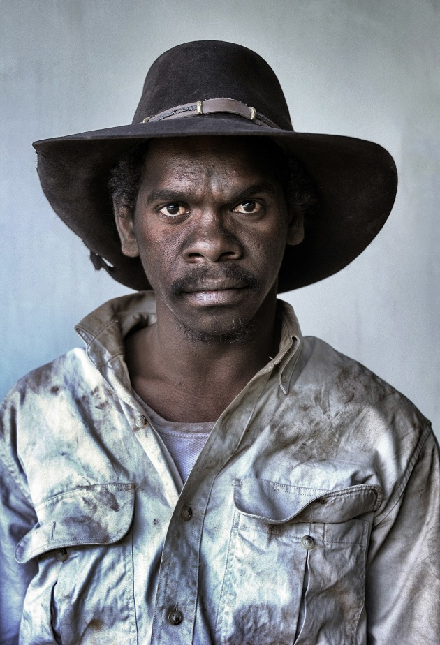 From the 'Aak Puul Ngantam Stockman' series, 'Dominic Ngakyunkwokka - Stockman'. Dominic Ngakyunkwokka is a young Indigenous stockman learning the ropes of the trade mustering on Cape York Peninsula. I made portraits of all the participants of the Aak Puul Ngantam mustering group, Indigenous and white, elderly and very young, as they returned from a gruelling day bringing in the wild cattle. This image was a prize winner at the Head On Portrait Prize 2013. Nikon D3S, Nikkor 28-300mm lens at 98mm, 1/50s @ F5.6, ISO 400.