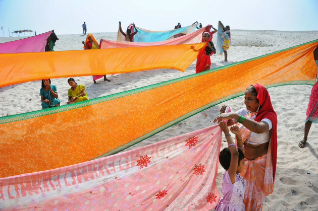 "Drying Saris on the Banks of the Ganges. An image from the essay ""India in an Ambassador"", a trip around a little of India in an  iconic Hindustan Ambassador taxi, which was based on the 1950s Morris Oxford, before the production line closed in 2014. Image made on the banks of Mather Ganga at Varanasi. Nikon D3S, Nikkor 28-300mm lens @ 28mm. 1/640s @ f6.3, ISO 200."