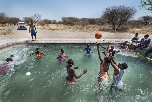 Children attending a bush camp run by Cheetah Conservation Botswana in the Kalahari (30km outside Ghanzi) take a refreshing break from the more formal activities of the day. My goal was to capture both a sense of place and freeze the action, so I chose the wide focal length of a 16mm and a fast shutter speed. Nikon D750, 16-35mm f/4 lens. 1/1000s @ f/9, ISO 560.