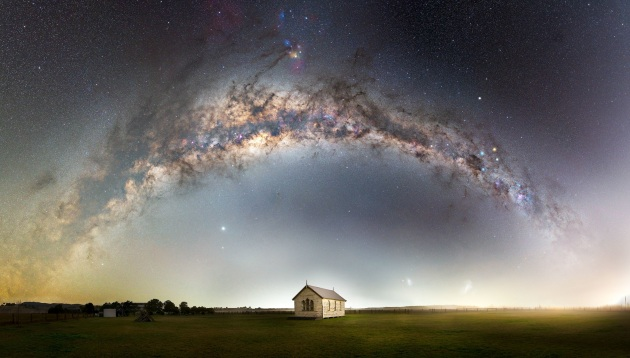 """© John Rutter - """"Heavens above""""  Hunter Valley, NSW – Australia This old church sits peacefully in a paddock in the Hunter Valley of NSW, Australia. That night, the forecast was for terrible weather, so I had written the night off and went home. To my amazement, the skies cleared and it was a race to get back to the location and start shooting. As the fog started rolling in towards the end of the capture, a perfectly timed car drove past to illuminate the scene and the fog. My passion is bringing the full Milky Way arch into people's homes via large panoramas. I would encourage everyone to head out to a dark sky and experience it. Camera or not, it is a truly amazing sight to stand under the full arch of the Milky Way."""
