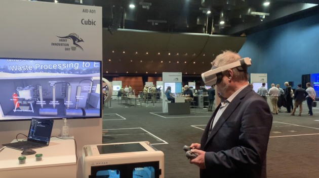ADM Deputy Editor Nigel Pittaway taking a virtual walkthrough of Cubic Defence's prototype Microwave-Assisted Pyrolysis System which utilises a pyrolytic process for converting waste into energy. (Credit: Roya Ghodsi)
