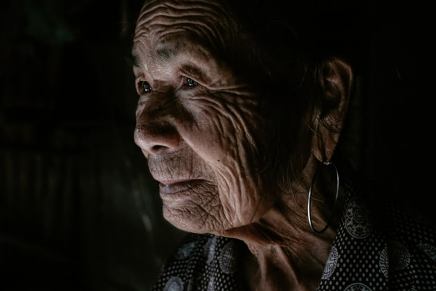 This portrait of an elderly Vietnamese woman standing in her front door was lit with natural light coming through the doorway next to her. The directional light meant that I was able to expose her face correctly and have the shadows sink into darkness.  Fujifilm X-T2, Fujifilm 23mm f/2 lens. 1/250s @ f4, ISO 1250. Contrast, saturation and sharpening in Adobe Lightroom CC