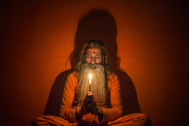 A sadhu sits inside his home holding a candle in his hands to create a surreal shadow behind his body. Compared to many underlit shots, this light gives him a sense of grandeur here. Without the under-light there would have been no shadow casting behind him. Canon 6D, Sigma 35mm f/1.4 lens. 1/80s @ f/1.4, ISO 3200. Noise reduction, contrast, saturation and white balance adjusted in Adobe Lightroom CC.