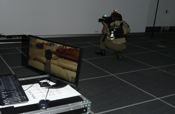 "MAJGEN Gus McLachlan led by example at the event and was keen to try his hand engaging with ""the enemy"" in a 3D immersive simulation demonstrator. Credit: ADM Patrick Durrant"