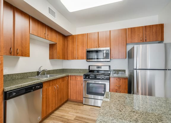 Gourmet Kitchens with Granite Counters and Gas Ranges at Dublin Station by Windsor, Dublin, 94568