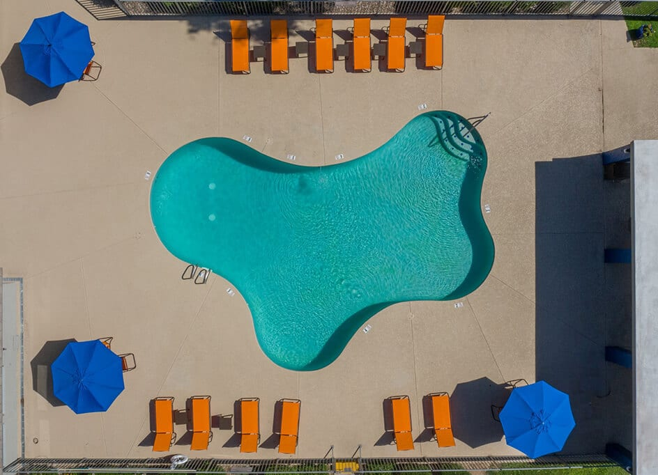 aerial view of swimming pool with pool furniture