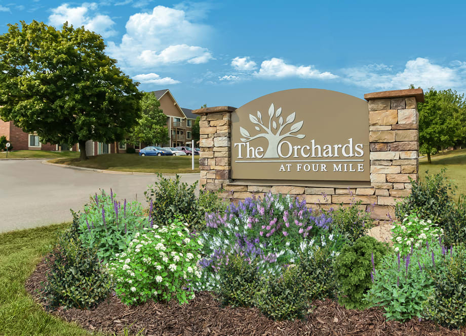 Beautiful landscaped entrance at The Orchards at Four Mile Apartments. Located in Grand Rapids, MI