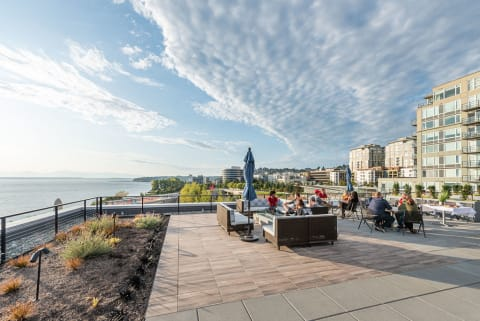 Rooftop Terrace View of Seattle Waterfront With Blue Sky and Scattered clouds at 10 Clay Apartments in Seattle, Washington