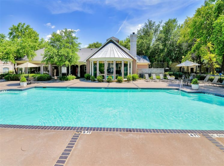 One of two pools with lush landscaping at Bentley Place at Willow Bend Apartments in West Plano, TX, For Rent. Now leasing 1, 2, and 3 bedroom apartments.