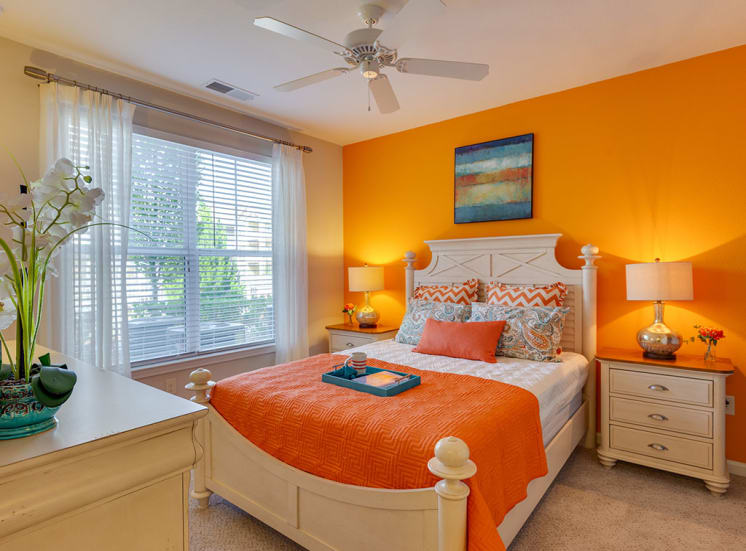Orange bedroom at luxury apartments in Charlotte NC