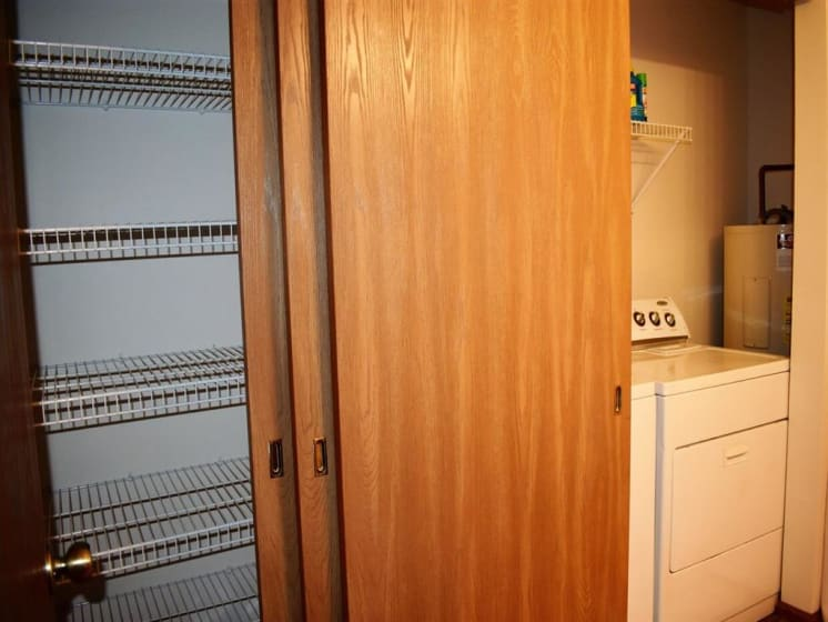 Built-In Shelving In Closet For Laundry Built-In Shelving In Closet at Deer Run Apartments, Brown Deer, WI, 53223