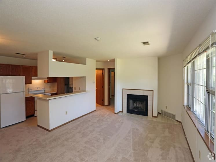 Fireplace And Kitchen Area View at Deer Run Apartments, Brown Deer, 53223